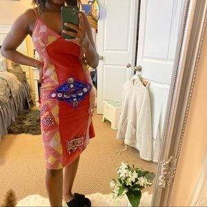 Unique dress with colourful embroidery details etc